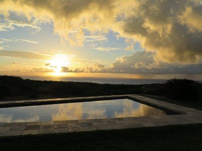 Pool at sunrise. View from the lanai and master bedroom.