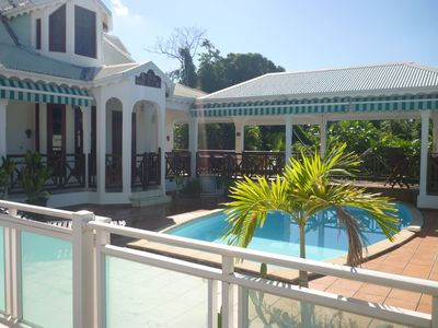 Photo for villa overlooking the Caribbean Sea with pool, near beach