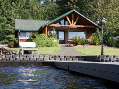 Photo for Cozy lakefront log cabin with personal private dock
