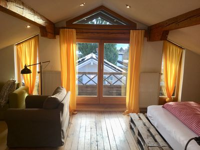 Photo for Charming holiday apartment with fireplace near the Simssee