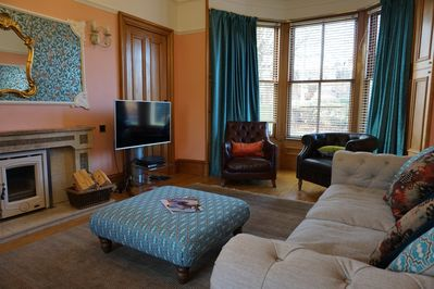 The sitting room has comfortable seating for 8, a wood-burning stove and Sky TV.