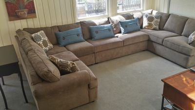We are always updating our home; new Klausner sectional sofa that seats 8 guests