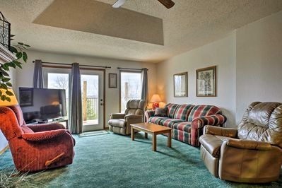 Relax on the plush furnishings while you watch the flat-screen Smart cable TV.