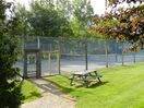 Tennis Court w/ rackets and balls in the unit