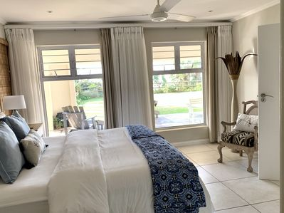 Bedroom looking out over green lawns and ocean views