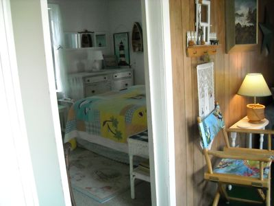 One bedroom with a double bed & cable T.V.