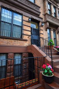 A modern (newly renovated) Manhattan brownstone townhouse awaits your arrival.