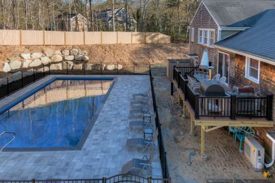Back yard with deck overlooking the pool.