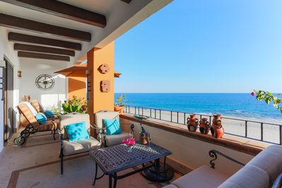 Spacious oceanfront balcony with decorative ceiling beams and gorgeous views