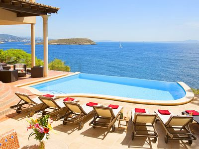 Photo for ENORMOUS LUXURY SEA FRONT VILLA, HEATED JACUZZI, INFINITY POOL, BEACH 5 MINUTES