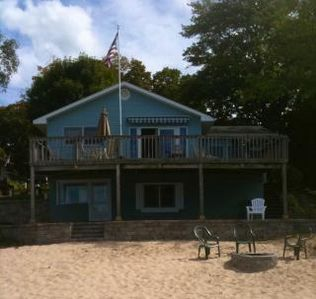 Beach side of lake house with 66 feet of private frontage on Silver Lake.