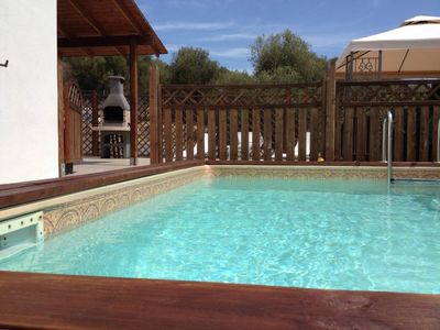 Photo for Villa with pool and housekeeper, 400 meters from beach of Porto Columbu (1 km from Pula)House with gardenBig house