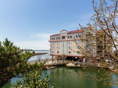 Photo for Spacious, waterfront apartment w/ a furnished deck - walk to the beach!