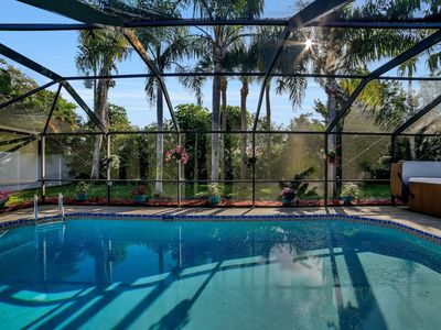 Photo for Tropical Paradise with Heated Pool
