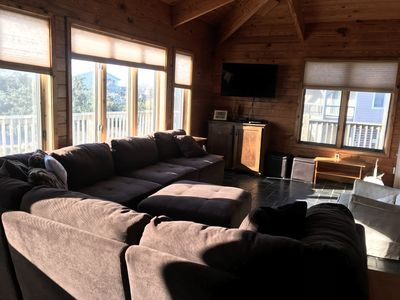Living room with lots of seating.
