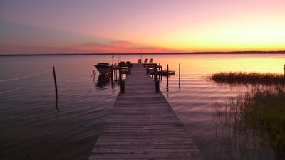 Year around exquisite sunsets in this 100' wide lake frontage