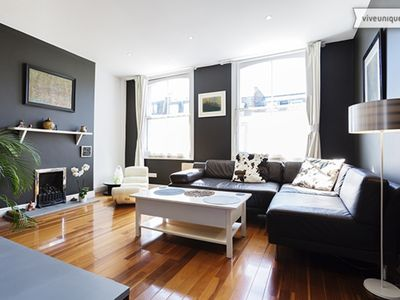 Photo for A colourful and stylish 2 bed home, in trendy London location (Veeve)