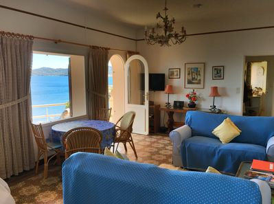 Sitting room with door to front terrace overlooking the sea