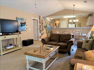 Photo for Whoa this condo sleeps 8 people! 5 miles from the beach!
