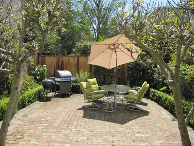 Photo for Bright, Renovated, 2 BR  Ground-Level Apartment. Beautiful Garden & BBQ.
