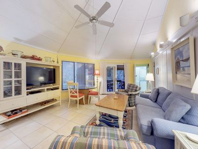 Photo for Cozy bungalow offers privacy, shared pool, and beach access via the boardwalk