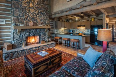 Gather together in this huge great room, with central, roaring wood fire, adjacent kitchen and dining room. Stone and wooden floors create a rustic farmhouse feel.  Prepare for step back in time.