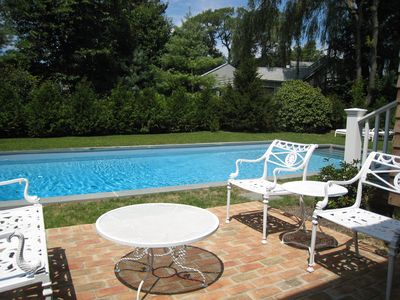 Relax poolside amidst professionally landscaped grounds.