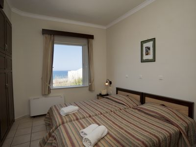 Photo for Seaside Suite 1B, waterfront, seaview & pool, directly on Gerani sandy beach