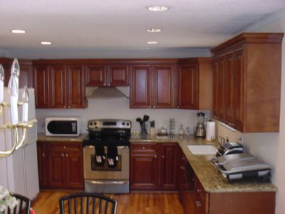 New cabinets, Granite counter, and fully equipped  kitchen.