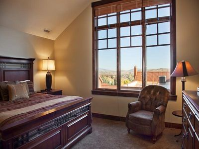 Master bedroom with King bed and flat screen TV and view of the mountains