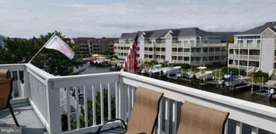 Photo for Bayside 2+2  Dockside water views! 4 blocks to beach, 1 block to North Side Park