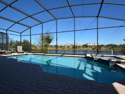 Photo for Gated 6BR Private Lake Front, Gameroom, Wifi, Heated Pool, BBQ, Disney Themed!!!