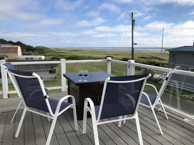 Enjoy drinks by the fire and watch the waves roll in