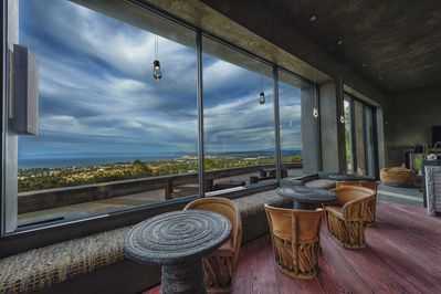 Ocean View Terrace, Pool-side cantina, sliding glass doors that provide a beautiful 360 view of Monterey bay and forest. 18- foot ceilings, modern Puebla's in 3 earth tones and 12 foot sliding glass walls to give indoor an outdoor experience.