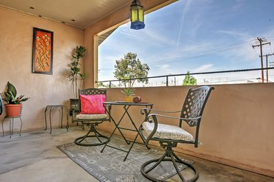 Indulge in a glass of wine while relaxing on this darling balcony!