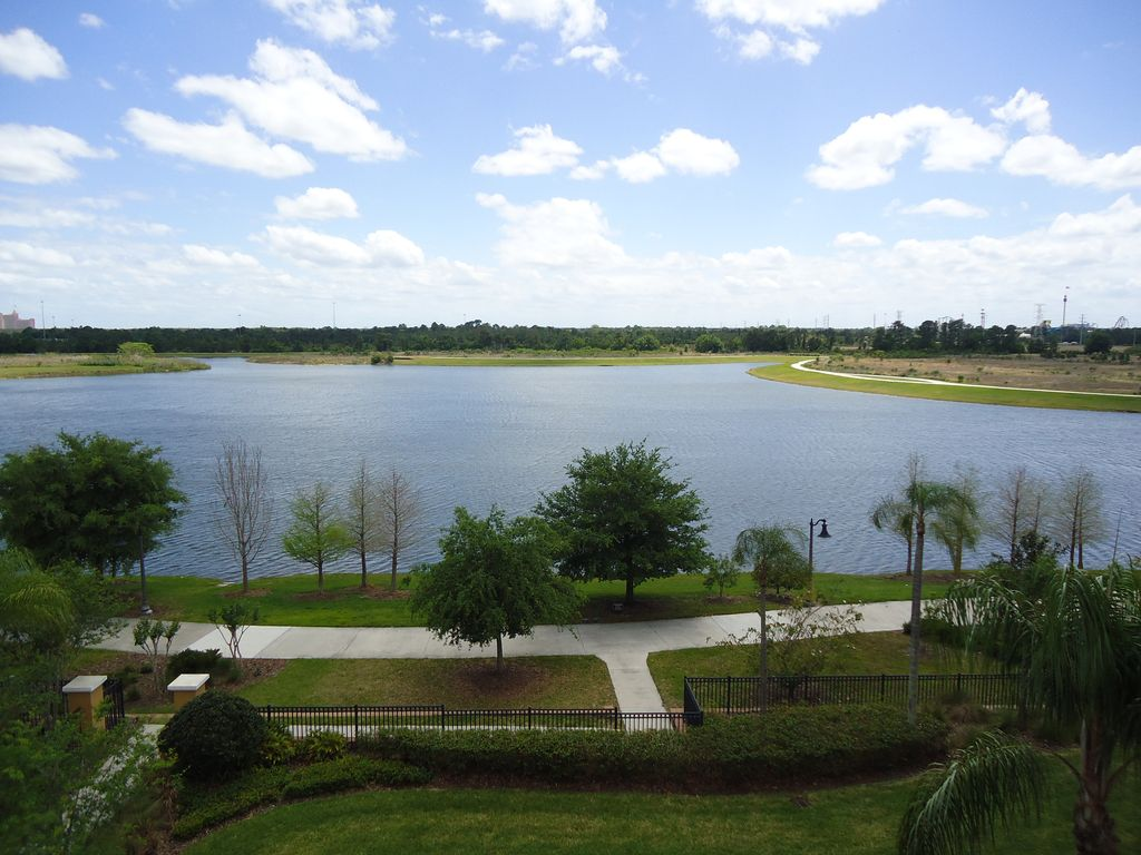 Villa bella vista cay penthouse lakefront condo for Sand lake private residences for rent