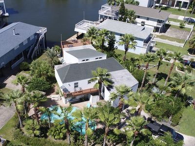 Photo for Tropical WATERFRONT home with PRIVATE POOL and boat slip, sleeps 9!