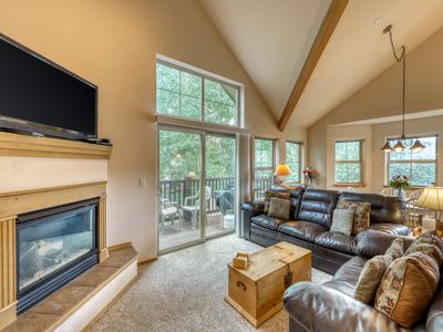 Photo for Modern condominium with fireplace & shared hot tub - close to town!