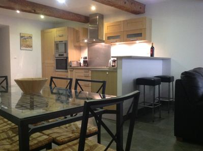 Granite and white oak kitchen  and open plan living area.