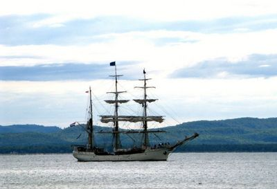 Three mast ship passing in front of the resort.