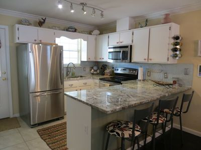 Granite Counter  top with state-of-the-art appliances and cooking utensils.