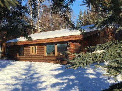 The cabin from the river in winter.