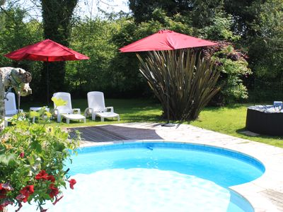 Photo for Converted Breton stone barn with heated pool in lovely setting