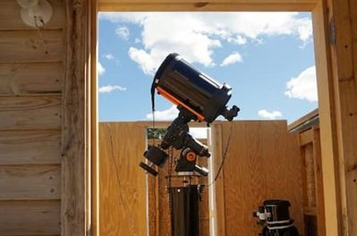 Celestron CGEM 1100 and Dobsonian telescopes in observatory