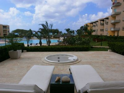 Photo for BEACHFRONT - EAGLE BEACH - OCEANIA RESORT - View Garden 2BR condo - A145