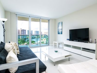 Photo for Modern condo w/ bay views. WiFi, parking, tennis, playground and more!