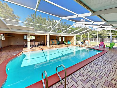 Photo for Enjoy a Private Screened Pool & Cabana - 4BR w/ Guest Suite, Near Dock