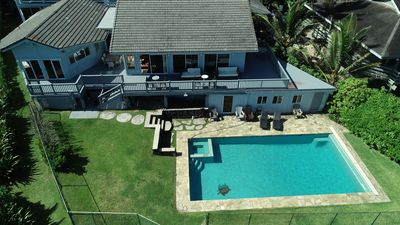 Photo for Beachfront Home w/ Oceanfront Pool near Sunset Beach. Steps from the Beach