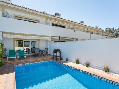 Photo for This 2-bedroom villa for up to 6 guests is located in Loule and has a private swimming pool, air-con