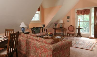 Upstairs living/dining/kitchen with vaulted ceilings